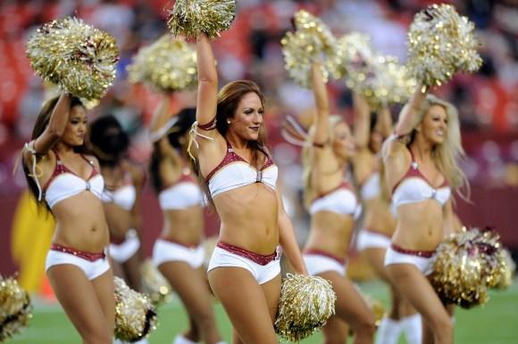 The Washington Football Team cheerleaders perform before an NFL preseason football game in Landover, Maryland in 2013.