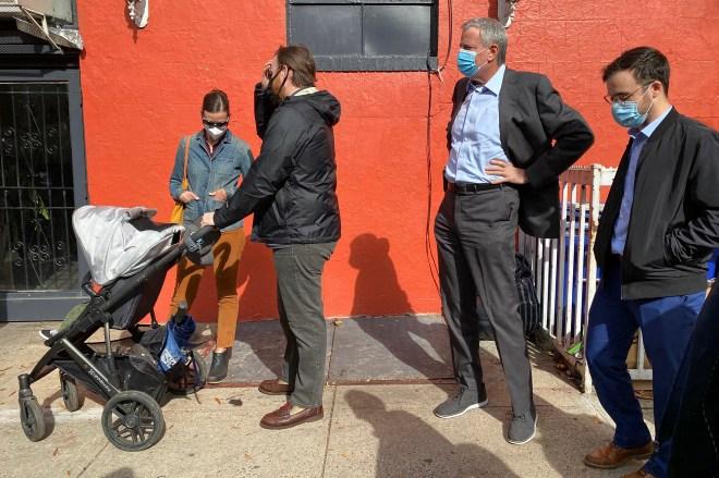 Bill de Blasio heckled as he waits in line to vote in Brooklyn