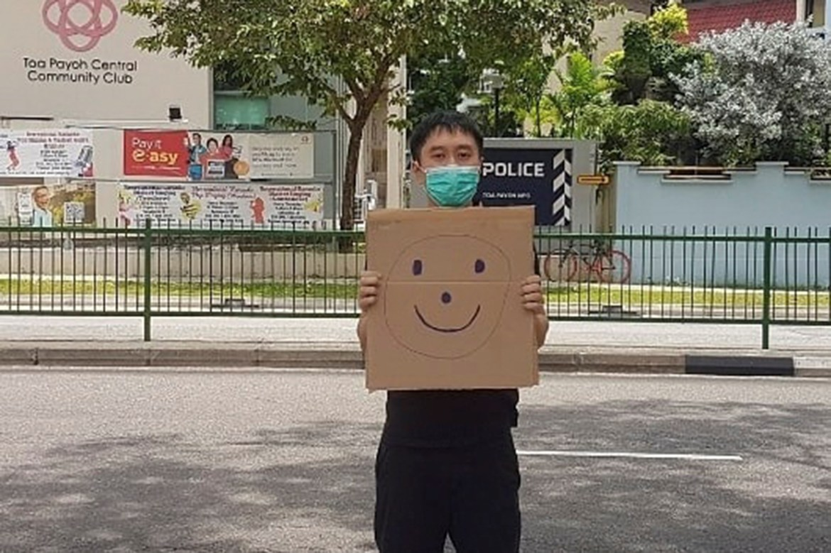 Singapore activist faces fine over one-man smiley face sign protest 1