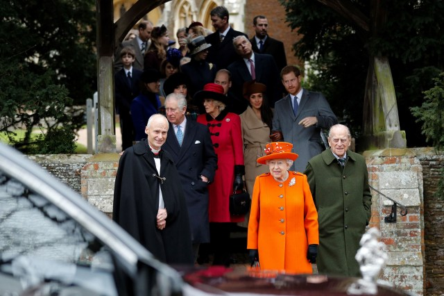 Queen Elizabeth II (center) and Britain's Prince Philip, Duke of Edinburgh (right) lead out other members of the family with Reverend Canon Jonathan Riviere (left) as they leave after attending the Royal Family's traditional Christmas Day church service at St Mary Magdalene Church in Sandringham, Norfolk, eastern England.