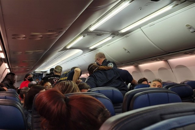 A passenger on a United Airlines flight with nearly 200 others onboard was pronounced dead shortly after the pilot made an emergency landing.