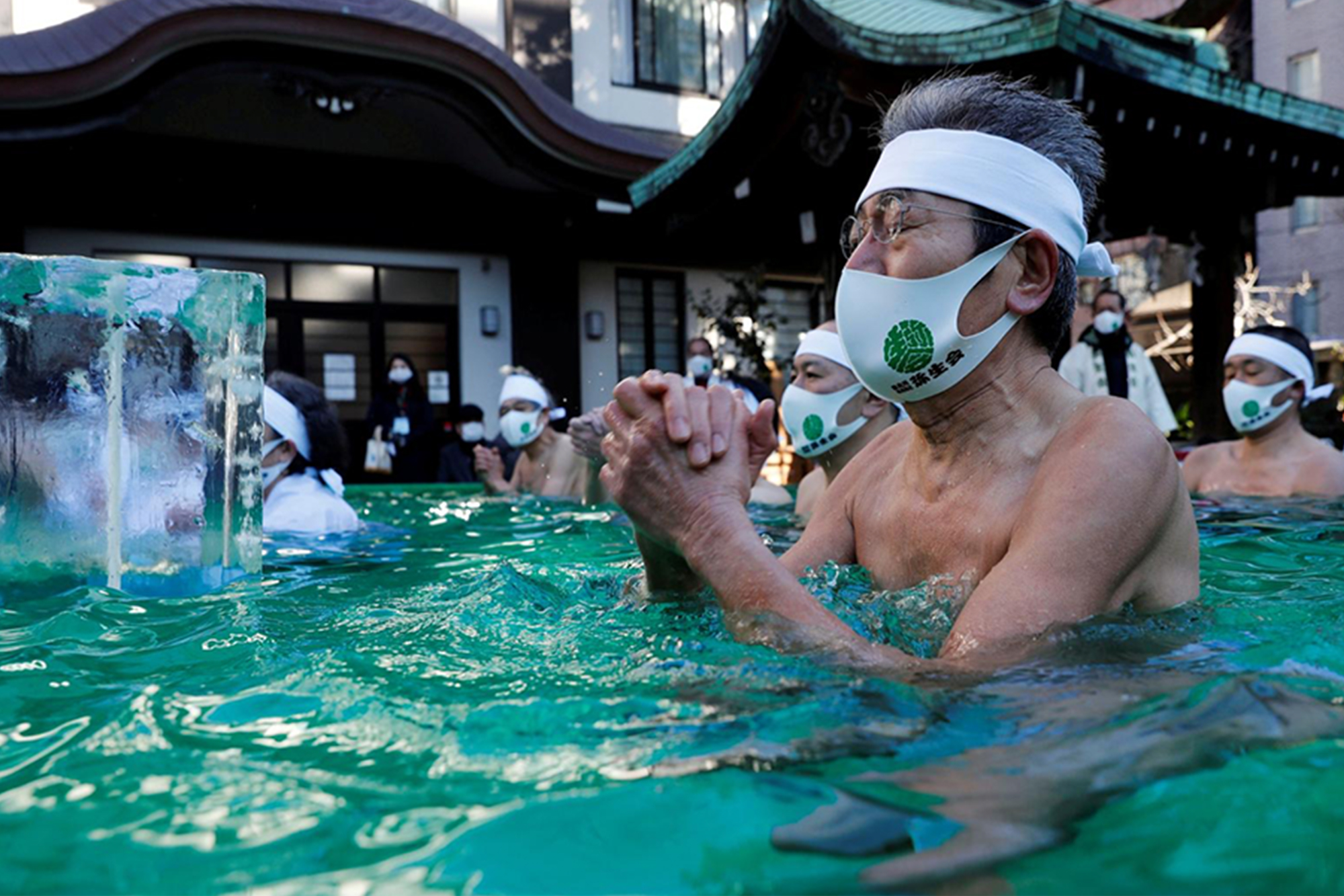 Japanese pray for the end of COVID-19 in ice-cold water