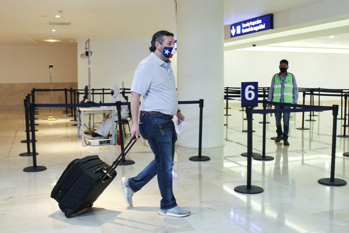 U.S. Senator Ted Cruz (R-TX) carries his luggage at the Cancun International Airport before boarding his plane back to the U.S., in Cancun
