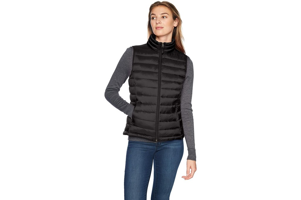 A woman in a black puffer vest