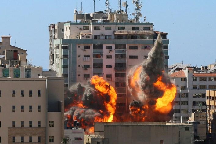 The al-Jalaa building housing Associated Press and Al Jazeera media offices is hit by an Israeli air strike.