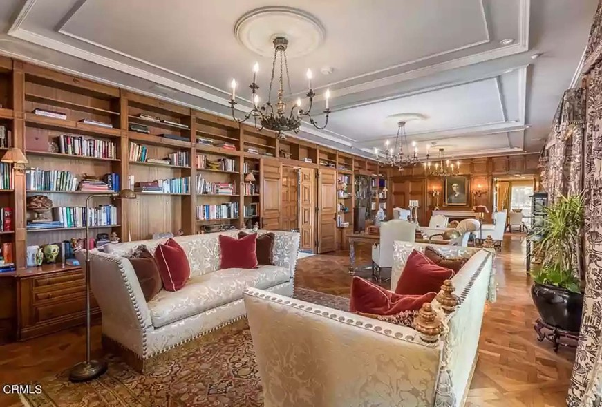 """The living room has two fireplaces at each end for """"intimate"""" gatherings, according to the listing."""