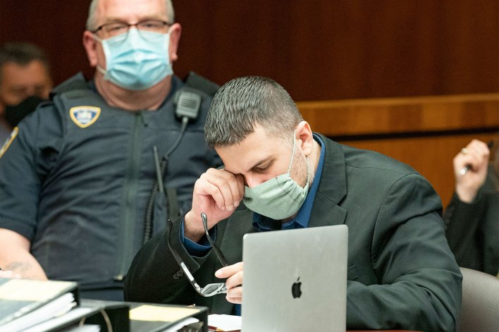 Michael Valva cries in court during the testimony of Det. Flores