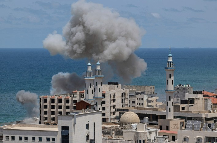 Smoke billows from the port of Gaza City following Israeli bombardment from the sea.