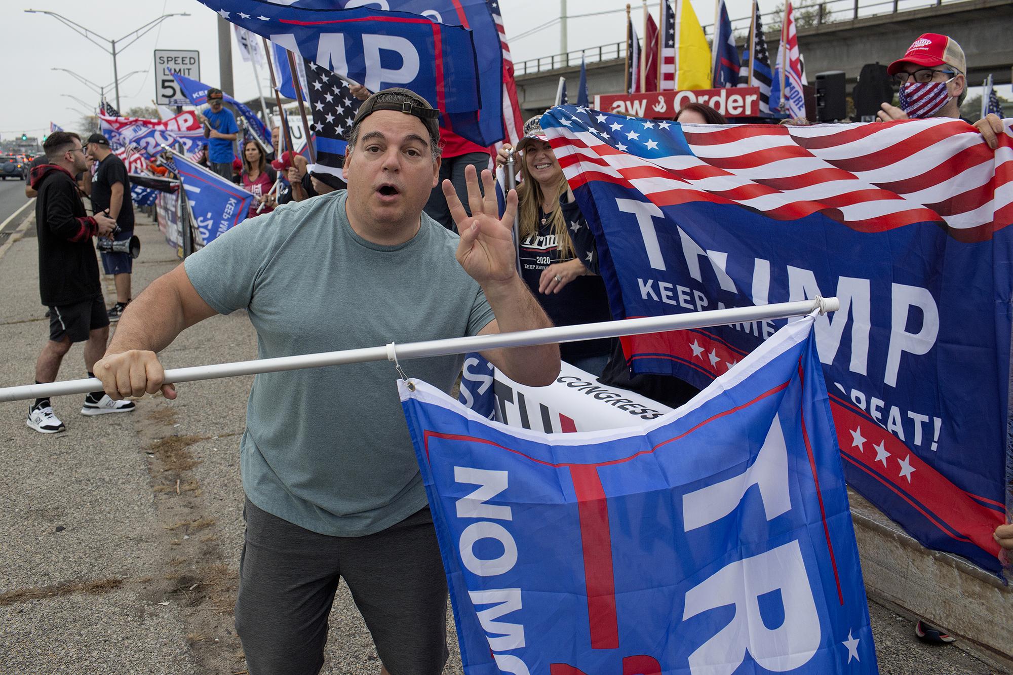 Trump supporters march a giant Trump flag through lower Manhattan