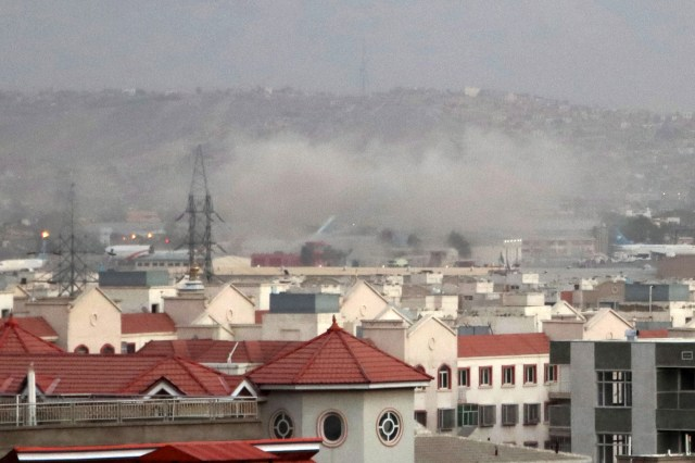 Smoke billows from the airport area after a blast outside the Hamid Karzai International Airport.