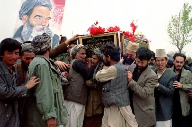 Followers took the coffin of Afghan opposition Shia Muslim leader Abdul Ali Mazari to the northern town of Mazar-e-Sharif for burial on March 27, 1995.