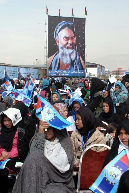 Afghan Shia women hold pictures of slain faction leader Abdul Ali Mazari during a Hazara gathering in Kabul.