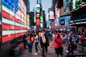 A flood of tourists gather in Times Square on June 16, 2021.
