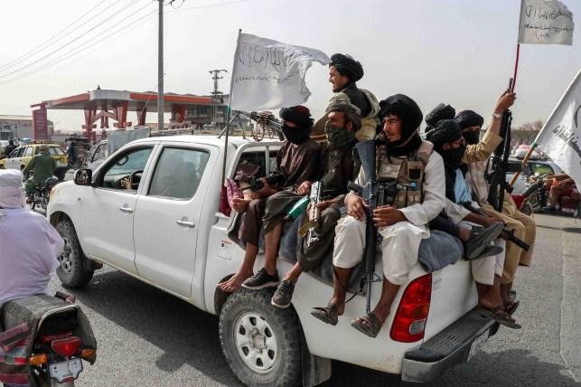 Taliban fighters patrol Kandahar, Afghanistan.
