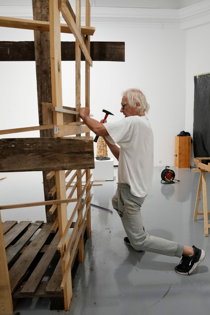 Lars Vilks, a Swedish artist, constructs an exhibit at the Ujazdowski Castle Center for Contemporary Art in Warsaw, Poland, Wednesday Aug. 25, 2021.