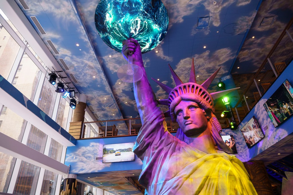 A 32-foot-high Statue of Liberty raising a tequila cup at Margaritaville in Times Square.
