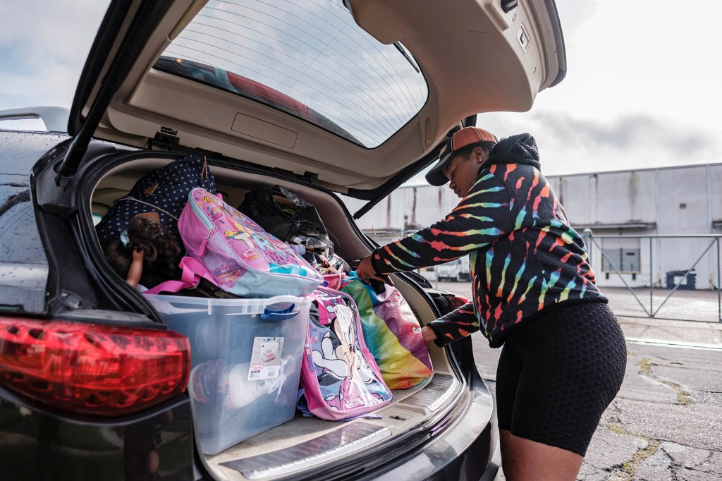 Jerica Washington packs her vehicle as she leaves for Texas before Hurricane Ida arrives in New Orleans on August 28, 2021.