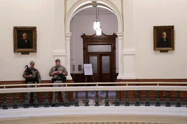Texas Department of Safety officers stand watch near the Texas House Chamber at the Texas Capitol, Wednesday, Aug. 11, 2021, in Austin, Texas