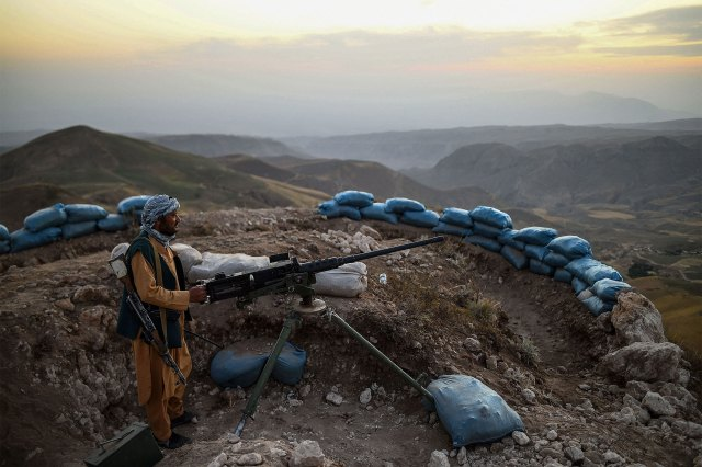 An Afghan militia fighter guards an outpost against Taliban fighters at the Charkint district in Balkh Province in Afghanistan on July 11, 2021.