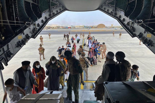 People in Kabul, Afghanistan, aboard a Spanish Air Force A400 as part of an evacuation effort.