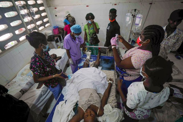 On Monday, August 16, 2021, two days after the 7.2 magnitude earthquake in the southwestern part of the country, health workers are treating an injured woman at the Amakoli Concept Hospital in Les Keys, Healthy.
