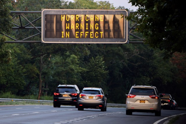 A sign on the Southern Parkway alerts drives that there is a Hurricane Warning in effect as Hurricane Henri moves up the coast on Aug. 21, 2021.