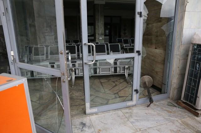 Broken Kabul airport doors.