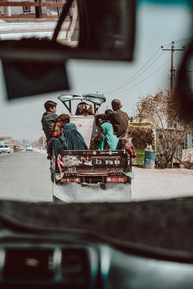 A family escape on a Zarang, a three wheeled motorbike as the fighting increases at the entrance to the city of Mazar-i-Sharif.