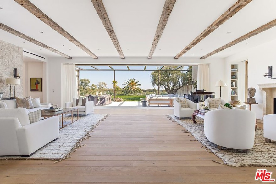 The exposed ceiling beams and open floor plan are visible in this photo.