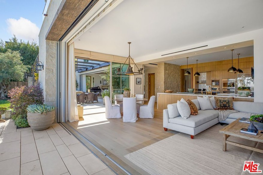 The indoor seating area seamlessly integrates with outdoor seating areas.