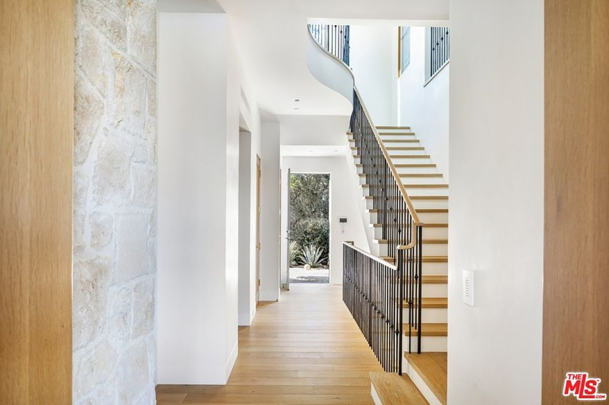 The home's neutral color palette is apparent as soon as guests enter the foyer.