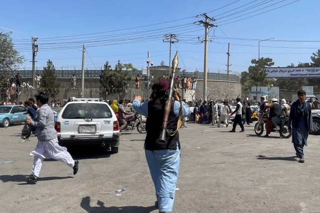 An armed Taliban militant patrols near the Hamid Karzai International Airport in Kabul August 16, 2021.