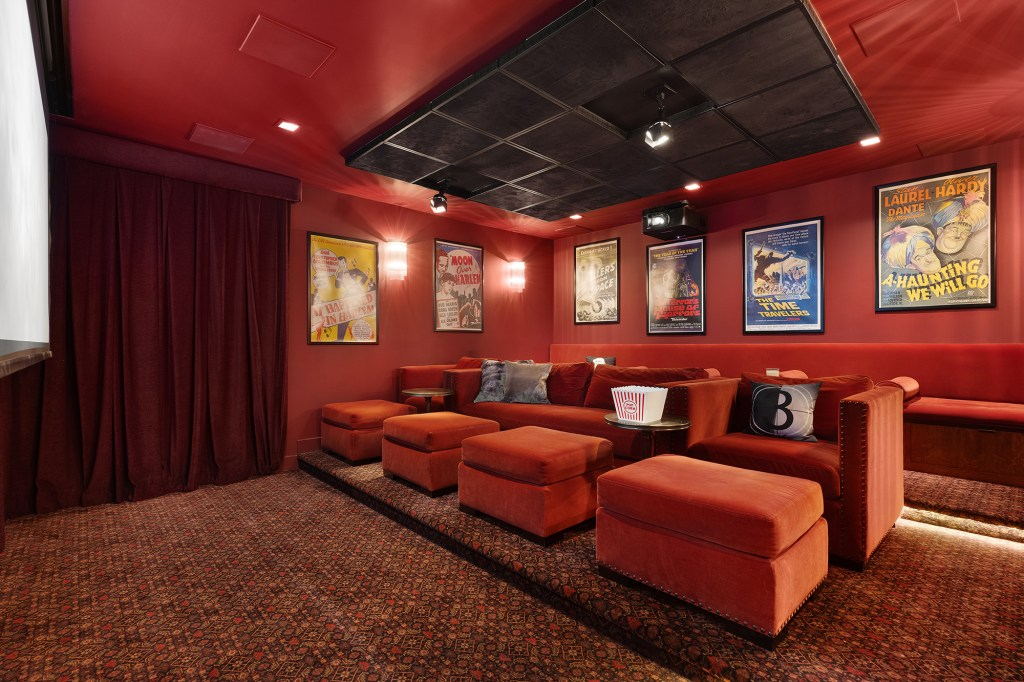 """The home theater is decked out in velvet red with seating for nine, where his family usually watched movies like """"The Kid Who Would Be King"""" on Sundays, he told The Post in 2019."""