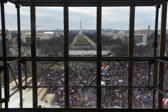 supporters of US President Donald Trump are seen from behind scaffolding as they gather outside the US Capitol's Rotunda on January 6, 2021