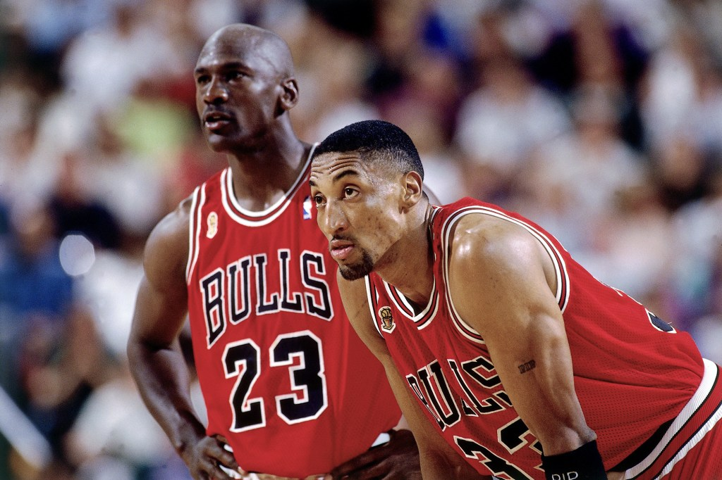 Michael Jordan and Scottie Pippen of the Chicago Bulls catch their breath during a 1996 NBA Game.