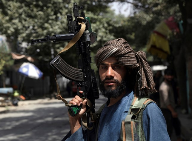A Taliban fighter guards a checkpoint in the Wazir Akbar Khan neighborhood of Kabul, Afghanistan, August 18, 2021.