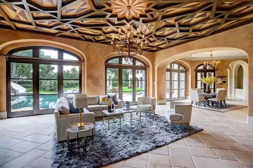 This family room has an intricate wooden ceiling.
