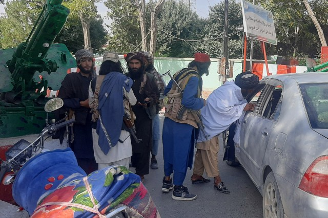 Taliban militants patrol after taking control of the Governor's house and the Ghazni city, in Afghanistan, 12 August 2021.