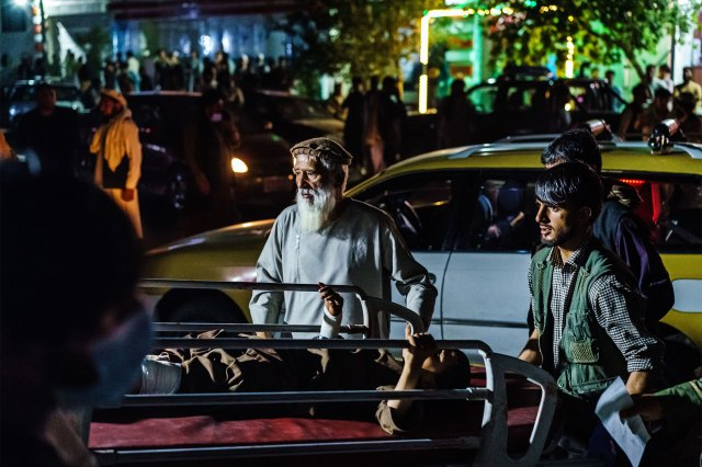 A wounded patient is brought by a taxi to EMERGENCY Hospital in Kabul, Afghanistan, Thursday, Aug. 26, 2021. Twin bombings struck near the entrance to Kabul's airport Thursday, ripping through crowds of Afghans and foreign nationals waiting for evacuation from the country. The explosions complicated an already-nightmarish airlift just before the U.S. deadline to remove its troops from the country.