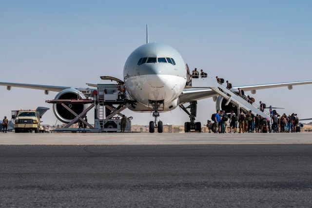 US Embassy personnel from Afghanistan boarding a plane to Kuwait after being evacuated to Qatar on August 17, 2021.