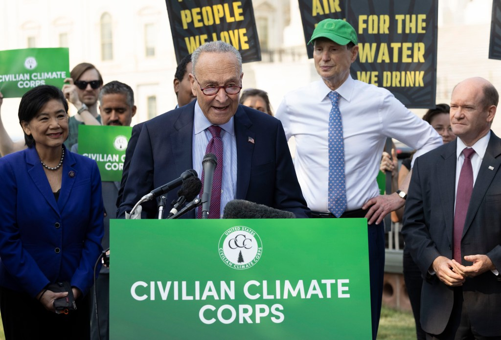 """Sen. Chuck Schumer and other legislators calling for the creation of a """"Civilian Climate Corps"""" at a rally on July 20, 2021."""