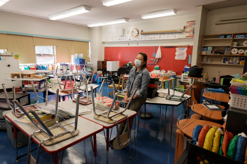 Laura Lai, a teacher at Yung Wing School P.S. 124, surveys her classroom in preparation for the upcoming start of school.