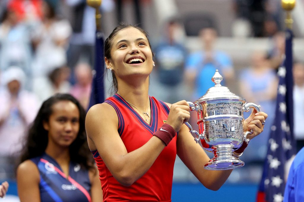 Emma Raducanu of Great Britain celebrates with the championship trophy after defeating Leylah Annie Fernandez of Canada in the 2021 U.S. Open final at the USTA Billie Jean King National Tennis Center on Sept. 11, 2021.
