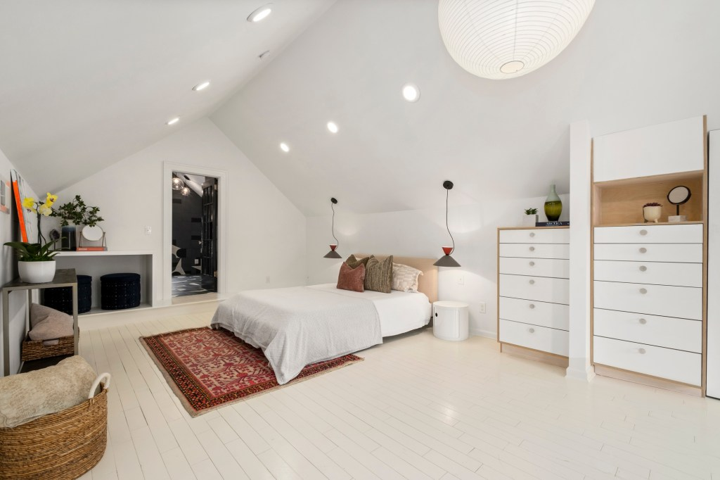 The master bedroom has an angular ceiling.