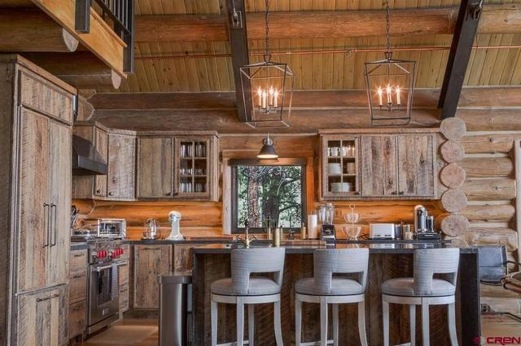 The kitchen features breakfast bar seating.