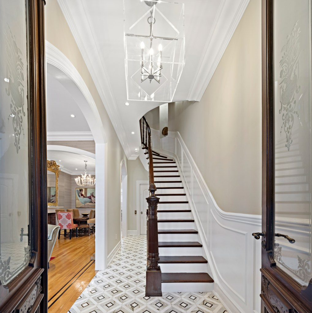 Upon entry is a foyer with historic finishes.