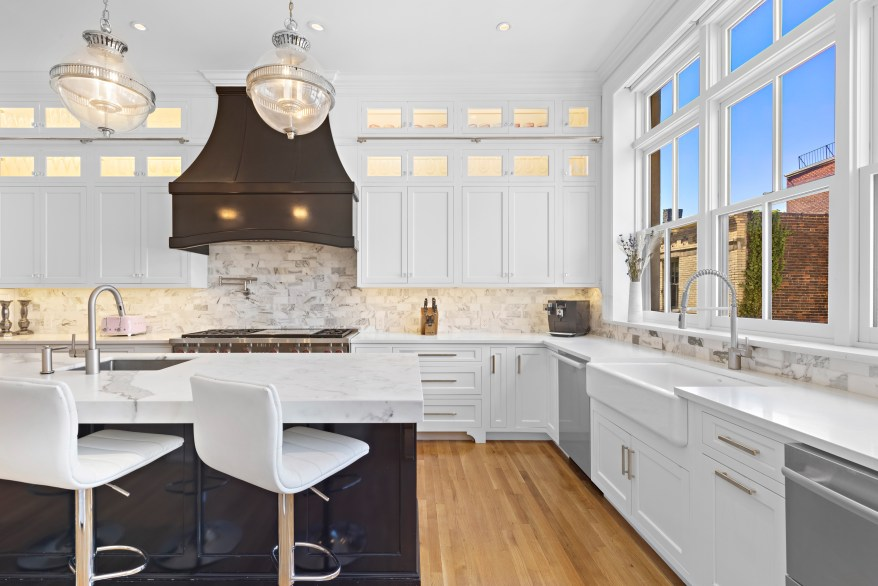 The kitchen also features island seating.