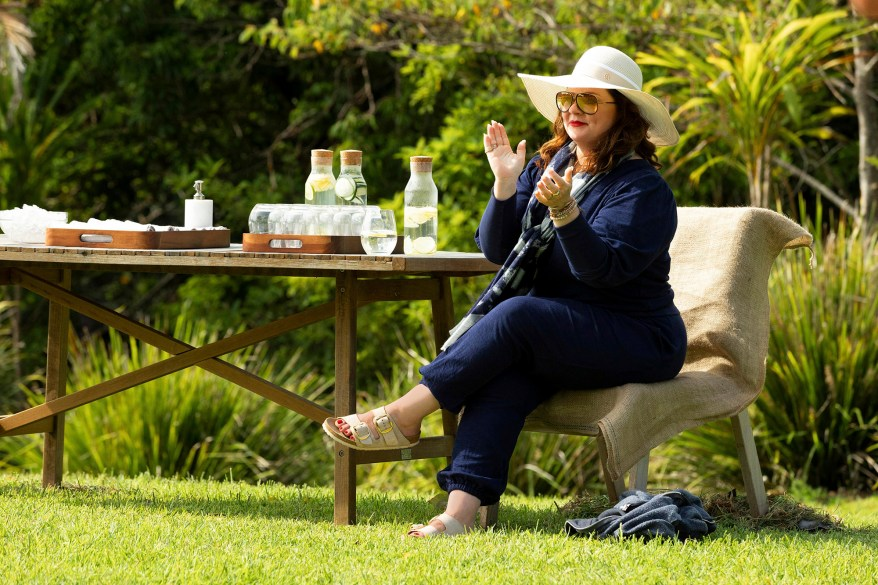 Melissa McCarthy claps from the sidelines on the estate.