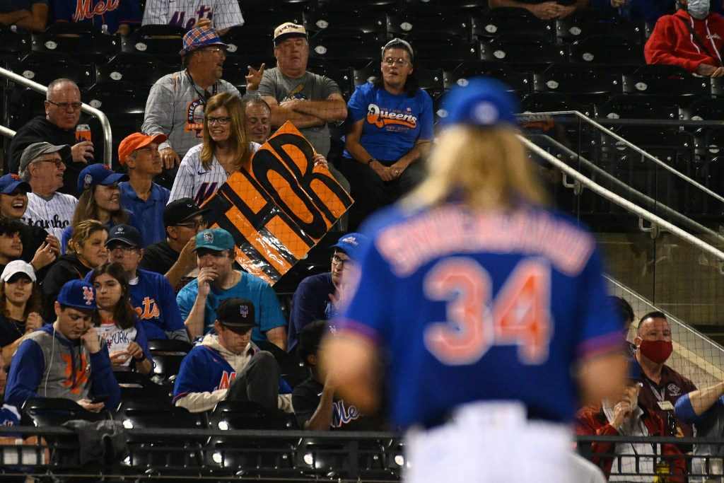 """A Mets fan holds up a """"THOR"""" sign for Noah Syndergaard in his long-awaited return"""