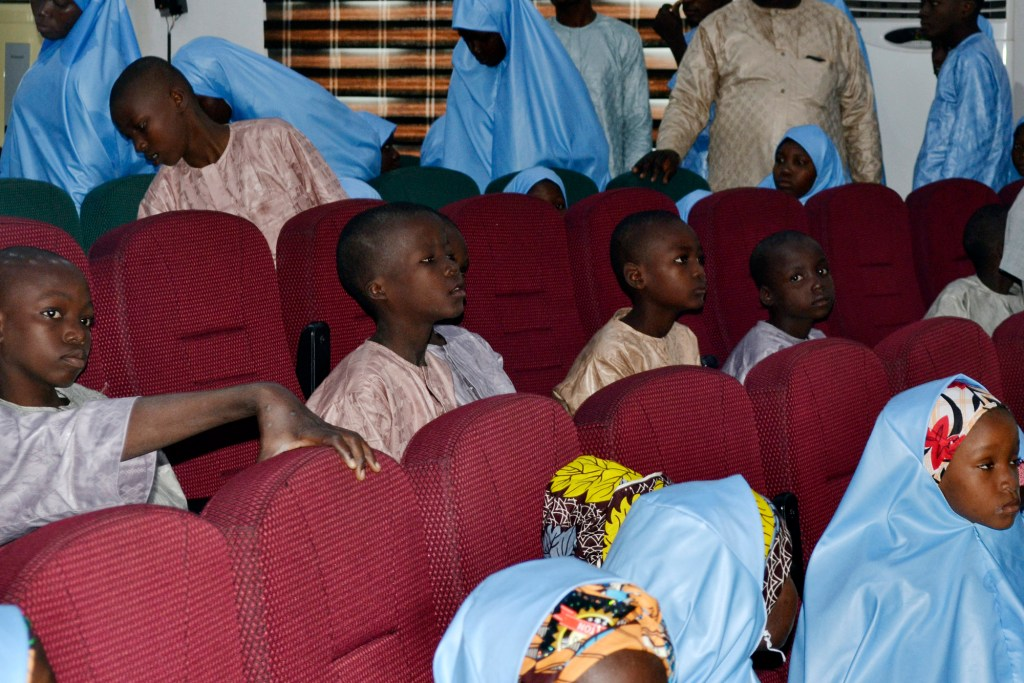 some freed students of the Salihu Tanko Islamic School gather before a meeting with Niger state governor in Minna, Nigeria